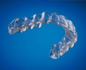 photo of invisalign by itself blue background