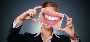 woman-smiling with photo of enlarged smile